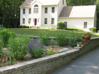 New Retaining Wall with flowers planted on top