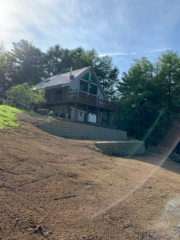 Cabin on hill with terraced retaining walls new hampshire